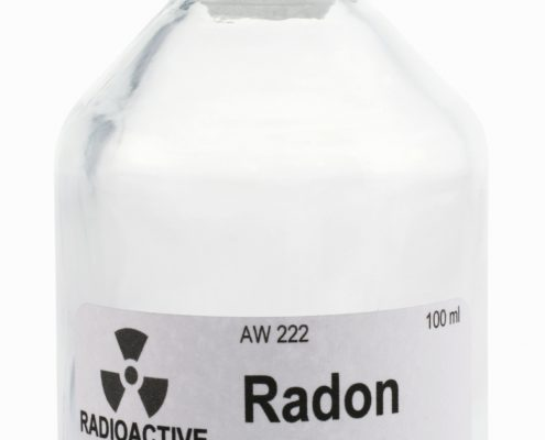 Bilde av en glassflaske med teksten Radon, Radioactive