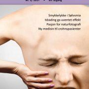 Forsiden på Spondylitten 1-17 med en rygg med et ansikt som kriker i smerte