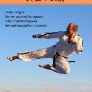 Forside Spondylitten 1-18 med mann som tar Taekwon-Do-spark høyt i luften