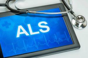 Bokstavene ALS skrevet på et nettbrett med et stetoskop oppå