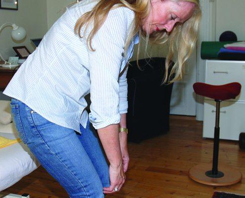 Kvinne viser nedsunken holdning
