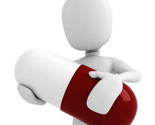 3D-figur holder en stor rød og hvit pille