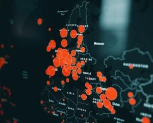 Kart over store deler av verden med røde sikrler for hvor det er Covid-19-smitte