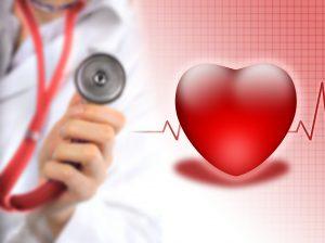 Lgehånd med stetoskop, tegning av hjerte med EKG-kurve bak